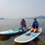 Helping a friend to start on the paddle board